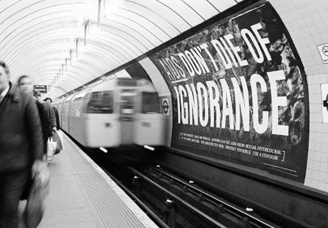 With an average of two people a day dying of AIDS in Britain, the government is blitzing the nation with warning posters as part of its 20 million pound (30-million-dollar) media campaign, March 5, 1987. This poster confronts passengers at the Kings Cross subway station in central London. The British Government approved an experimental drug - AZT - which is manufactured by the Welcome Foundation Drug Company, for the treatment of AIDS. (AP Photo/Gillian Allen)