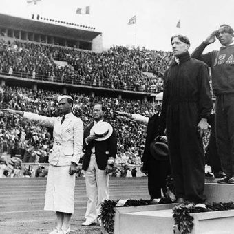 1936: Jess Owens accepts his Olympic 100m Gold medal