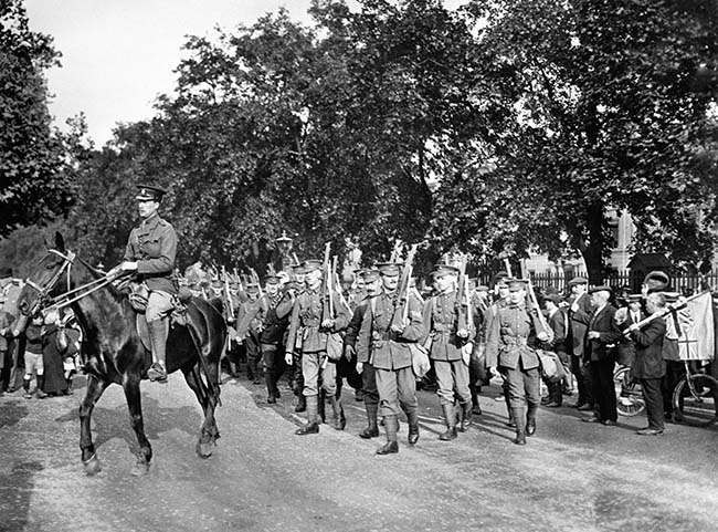 The Grenadier Guards are watched by a crowd as they leave Wellington Barracks in London for active service in France at the beginning of the Great War.