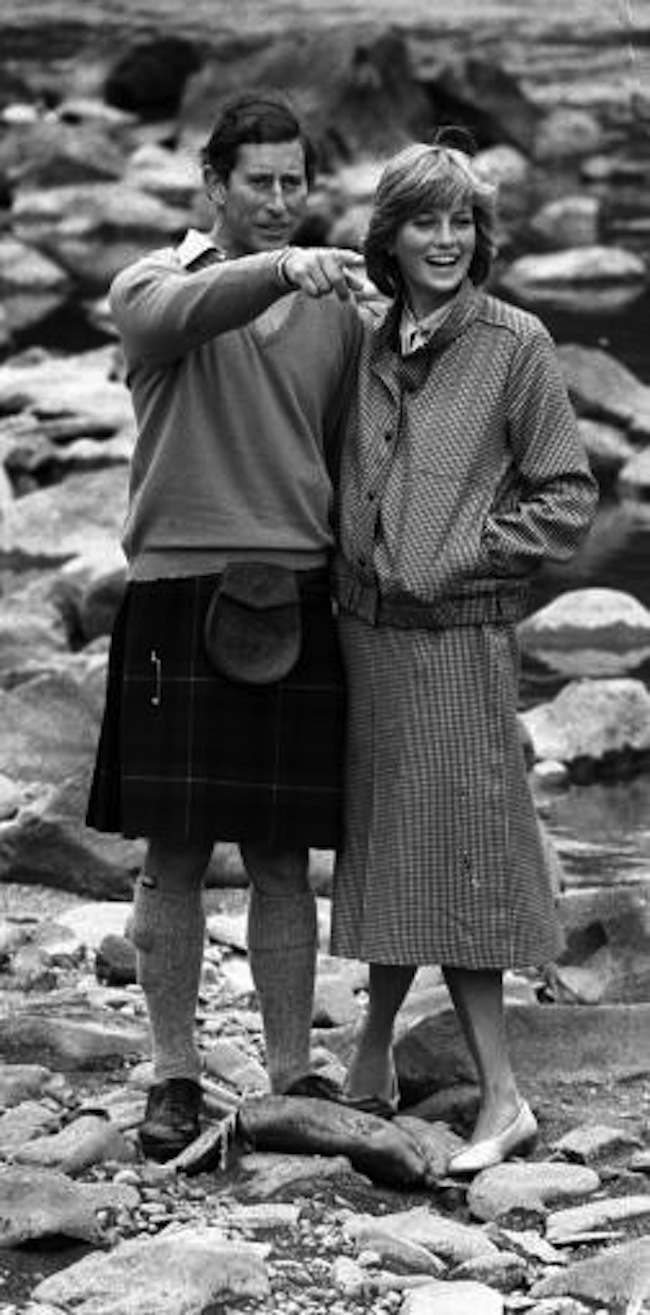 The Prince and Princess Of Wales take a break during their country stroll along the banks of the River Dee, during their holiday at Balmoral Castle where they are staying with The Queen and other members of the Royal Family.