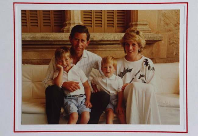 A Christmas card from Prince Charles and Diana, with a picture of the couple with Prince William and Prince Harry, on display at Omega Auctions in Stockport, which is going on sale in a lot with eight other Christmas cards sent by the Prince and Princess of Wales over successive years.