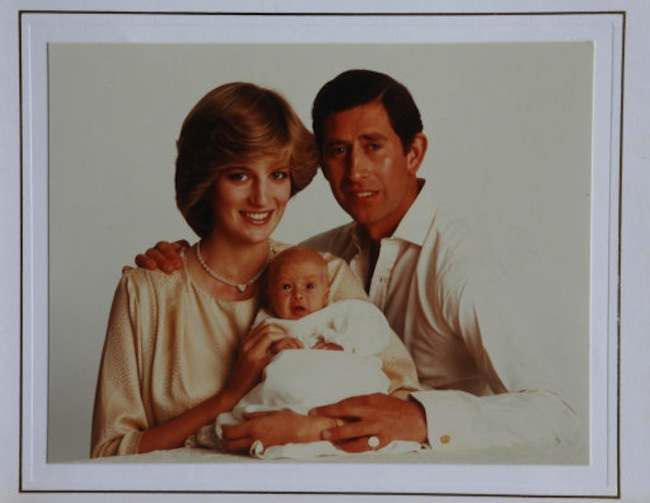 A Christmas card from Prince Charles and Diana, with a picture of the couple with Prince William, on display at Omega Auctions in Stockport, which is going on sale in a lot with eight other Christmas cards sent by the Prince and Princess of Wales over successive years.