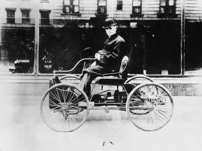 Henry Ford is seen on the Quadricycle, the first automobile he ever built in Dearborn, Mich.
