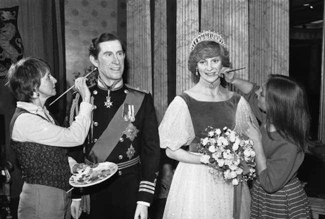 New wax portraits of the Prince and Princess of Wales when they went on show for the first time at Madame Tussaud's in London on May 28, 1983. The portrait of the prince is by Judith Craig and wears the uniform of a Royal Navy Commander. The one of the princess is by Muriel Pearson and wears an evening dress. (AP Photo/Joe Schaber)