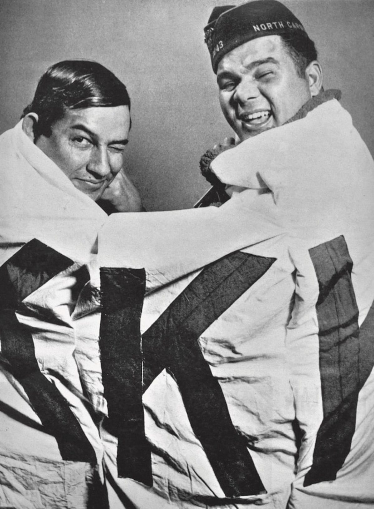 Charlie Warriax (left) and Simeon Oxendine (right) bear a captured KKK banner. Courtesy of the Charlotte Observer Photograph Collection, Public Library of Charlotte and Mecklenburg County.