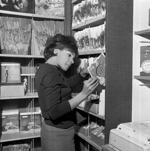 Singer Shirley Bassey browsing at her Record Shop, West End Lane, London