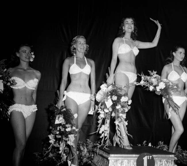 MISS WORLD 1951: 'The prettiest girl in Sweden'. Miss Kerstin 'Kiki' Hakansson, who became Miss World 1951 at the Lyceum Ballroom, Strand, London. In the scantiest of bikini costumes, the 22 year Swedish girl won a 1000 prize as well as the title.