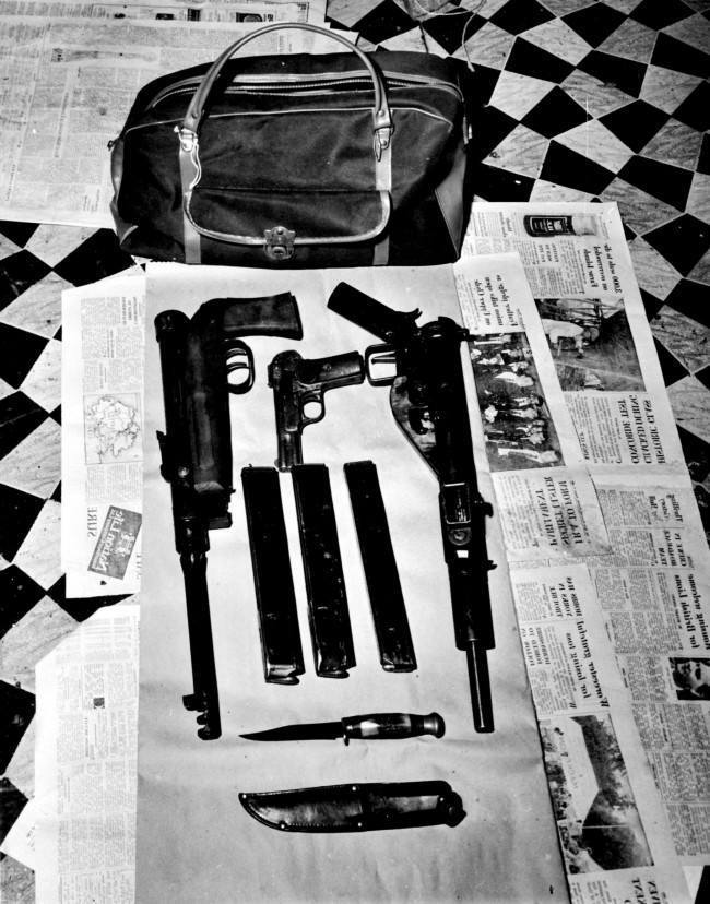 Scotland Yard issused this picture of a holdall and the weapons it contained. Some of the exhibits which helped to convict four of the accused in the Angry Brigade trial at the Old Bailey. *Police said the automatic weapons were used in attacks on the American and Spanish Embassies in London. The Holdall and it's contents were found at a flat in Amhurst Road,Stoke Newington, North London.