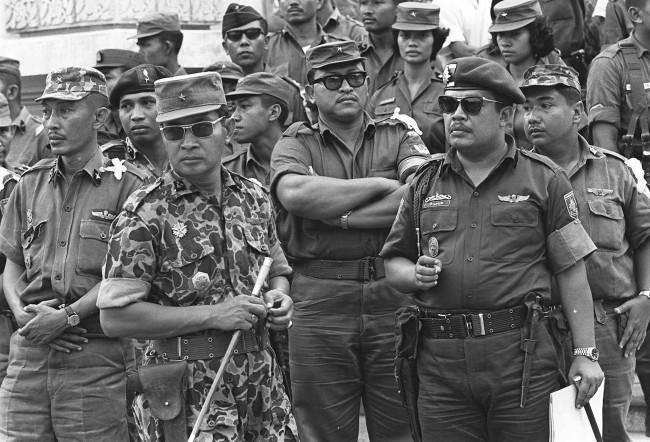 Maj. Gen. Suharto, 2nd left with sunglasses, is shown in this Oct. 6, 1965 file photo. Former dictator Suharto, an army general who crushed Indonesia's communist movement and pushed aside the country's founding father to usher in 32 years of tough rule that saw up to a million political opponents killed, died Sunday January 27, 2008. He was 86. (AP Photo, File)