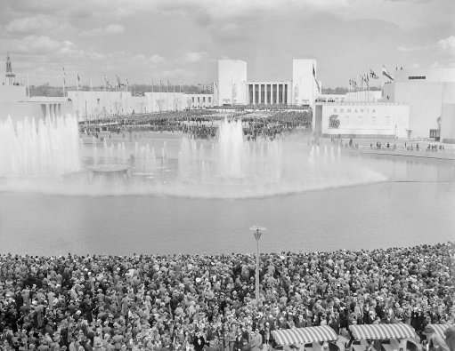 The splendor of the New York's World Fair in 1939 was evidenced, showing the entrance to the Court of Peace and the Lagoon of Nations where a nightly fountain displays of many colors was a featured event. Now there is nothing left but a sunken roadway and a rotting bridge across the lagoon, now Flushing creek. (AP Photo)