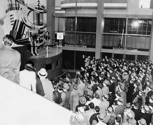 Jamming every inch of space in the huge Hall of Electrical Living at the Westinghouse Building at the World's Fair in New York on May 8, 1939, crowds stand 6 deep on the sidewalk outside the glass-enclosed structure to watch Elektro, the Westinghouse Moto-Man, perform his 26 mechanical tricks, including, walking, talking, smoking a cigarette and counting. (AP Photo)