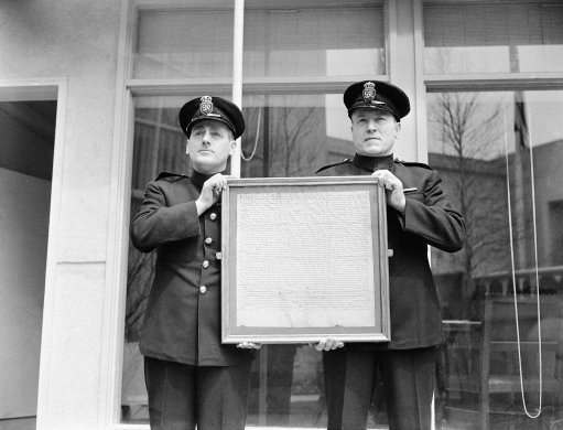 Here are two guards at the British Building supervising the installation of a copy of the famed Magna Carta as one of the exhibits at the world's fair in New York on April 29, 1939. The fair was set to open on April 30. (AP Photo)