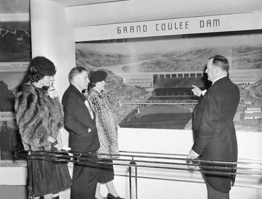 These prominent representatives of the state of Washington are looking at a diorama of Grand Coulee dam, part of their state's exhibit at the New York World's Fair on May 1, 1939, after opening day ceremonies on April 30. Shown (left to right) are Mrs. E.B. McGovern, U.S. Senator Homer Bone (D-Wash), Mrs. Bone, and Comm. E.B. McGovern, Representing the governor. (AP Photo)