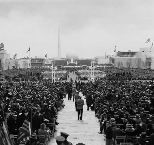 "President Roosevelt opened on April 30 the New York world's fair. He emphasized it as typifying America's desire for peace and peaceful trade. A general view of part of the 35,000 guests of honor who listened to the president's opening speech in the ""court of peace"" at the New York world's fair on April 30, 1939."