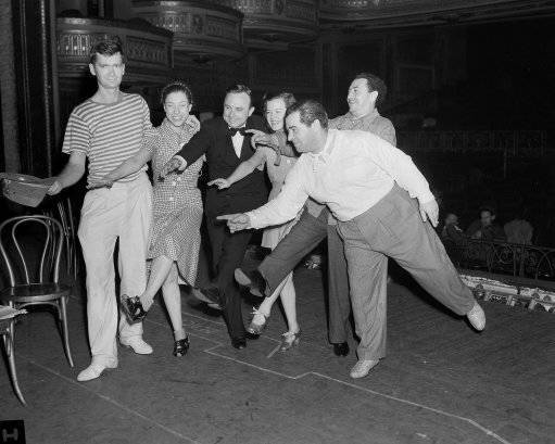 "Some of the stars of ""Yokel Boy"" show Gov. E. D. Rivers of Georgia how to dance in the line of a musical comedy in New York, June 14, 1939. The Gov. is in New York to see his state's exhibit at the World's Fair. Left to right are: Buddy Ebsen; Judy Canova; Gov. Rivers; Dixie Dunbar; Jack Pearl and producer Lew Brown. (AP Photo)"
