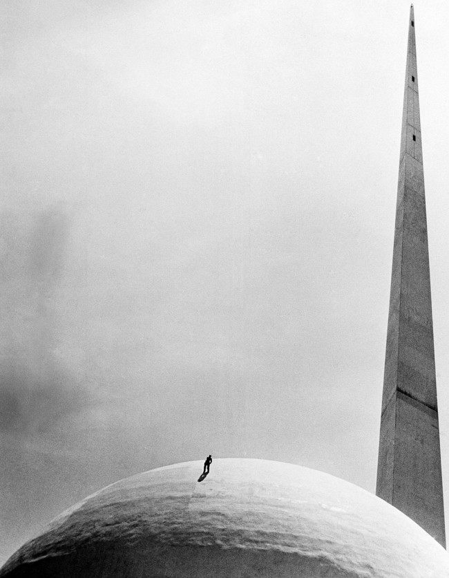 A workman at New York World's Fair repaints the famed Perisphere, on June 6, 1939. (AP Photo)