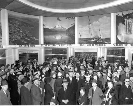 Photo shows a crowd of people inspecting part of the state of Washington's exhibit at the New York World's Fair shortly after it opened April 30, 1939.