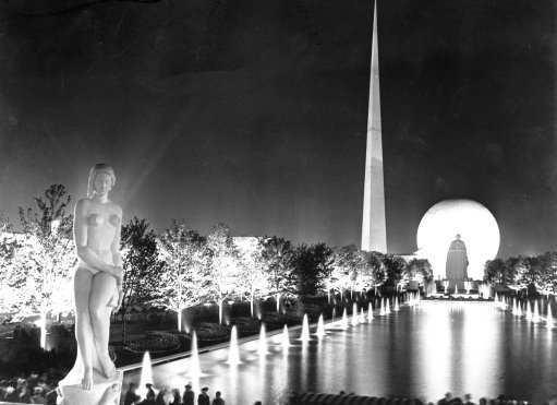 Unique lighting produces this scene on Constitution Mall at New York's Worlds Fair, May 13, 1939. In the foreground at the left is the statue