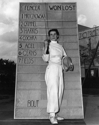 National women's champion Helena Mroczkowska, 22, of Hicksville, N.Y., poses in front of the leader board at the start of a fencing championship at the World's Fair in New York in Sept. 15, 1940. Mroczkowska Dow, a four-time national fencing champion and a former U.S. Olympic member, has died of cancer Wednesday, Arpil 22, 1998. She was 80. Dow, part of a famous Olympic family, won the first of her four Amateur Fencers League of America national foil championships in 1940. She also won the title in 1943, 1947 and 1948.