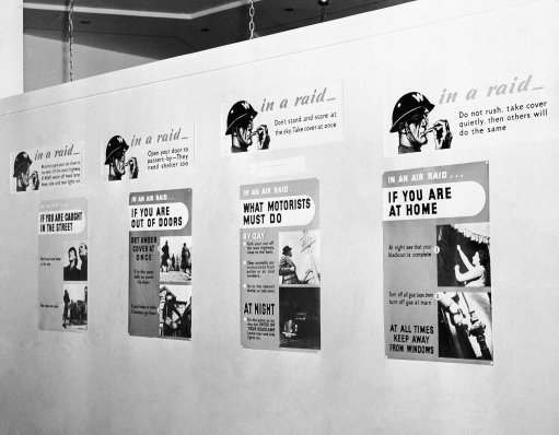 Here are air raid warnings, posted in English cities, as they appear at the British pavilion of the New York world's fair Sept. 3, 1940. Each poster has a warning covering most of actions of civilian populations.