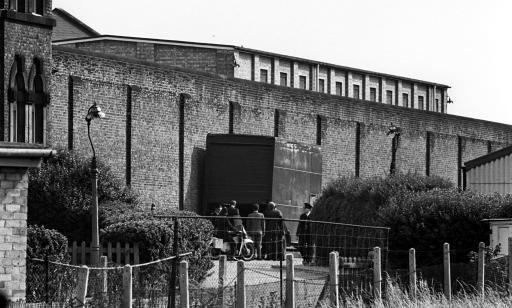 By the wall of Wandsworth Jail in South London, police work on the pantechnicon used in the escape from the prison of Ronald Biggs