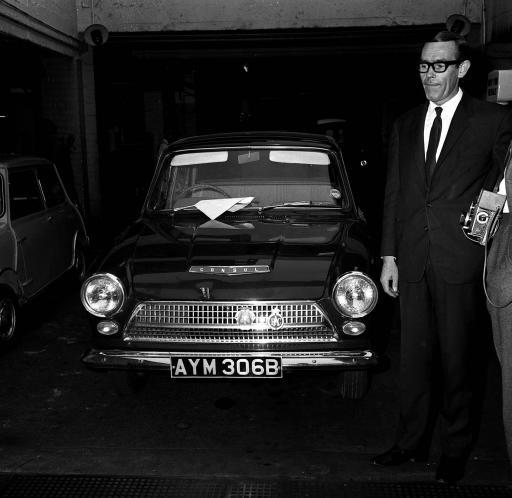 1965: The green Ford Cortina, one of the getaway cars used in the escape of train robber Ronald Biggs and 3 other men from Wandsworth prison last week. The car was found abandoned in a street in Holloway, London. To the right is Mr Torrington, owner of Autohall Car Hire from which the car was hired.