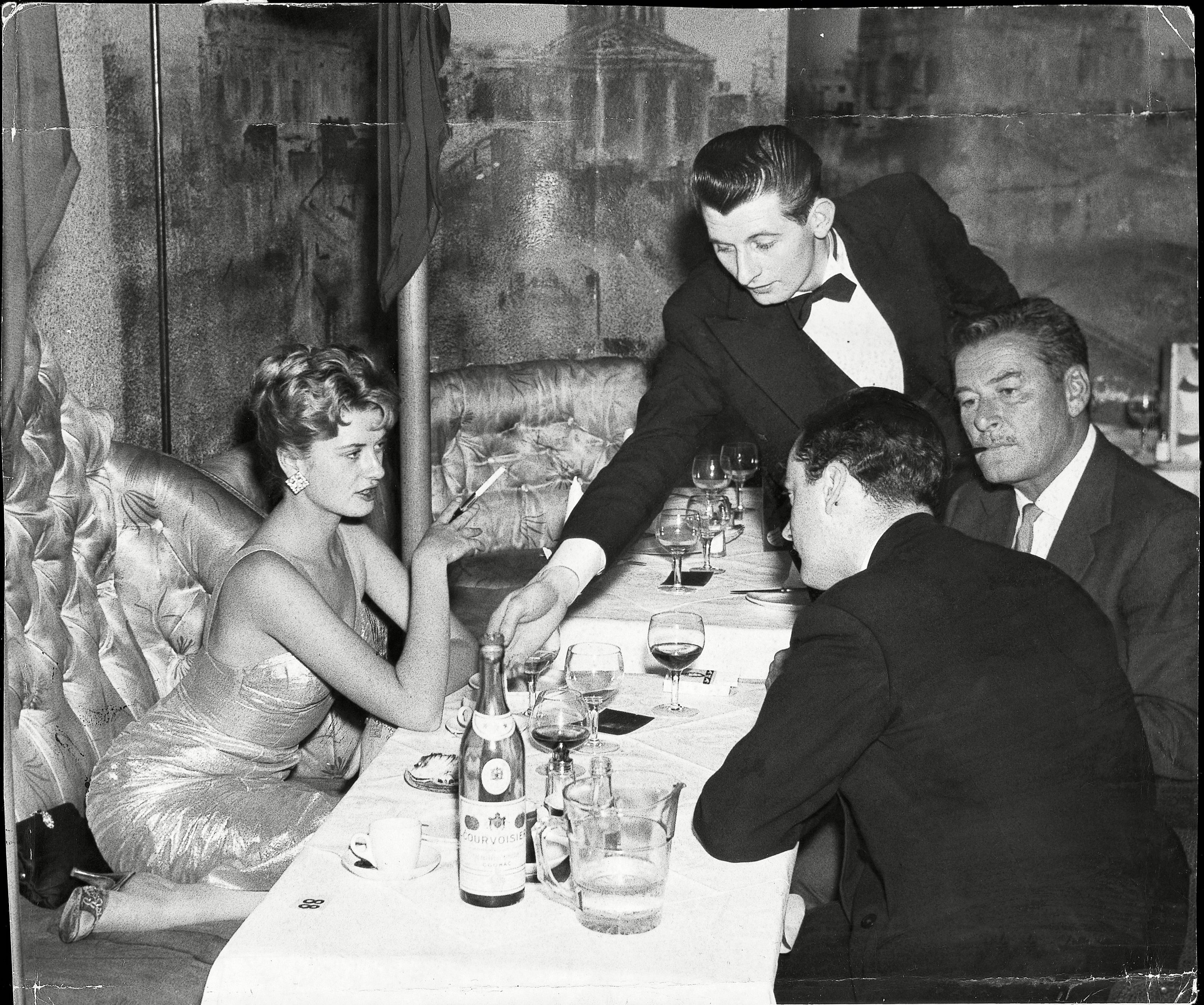 Errol Flynn Pictured With Beverley Aadland at The Lido Nightclub on Swallow Street, just off Piccadilly, 5th May, 1959. The Couple Starred In The Film Cuban Rebel Girls And Had A Highly Publicised Relationship For The Last Two Years Of Flynn's Life.