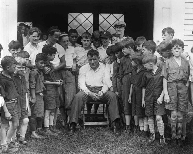 Gene Tunney, American Heavyweight Champion of the World, with a group of young admirers, at Spectator, near New York, USA, July. 19, 1928, where he was training for an upcoming fight with Tom Heeny. (AP Photo)
