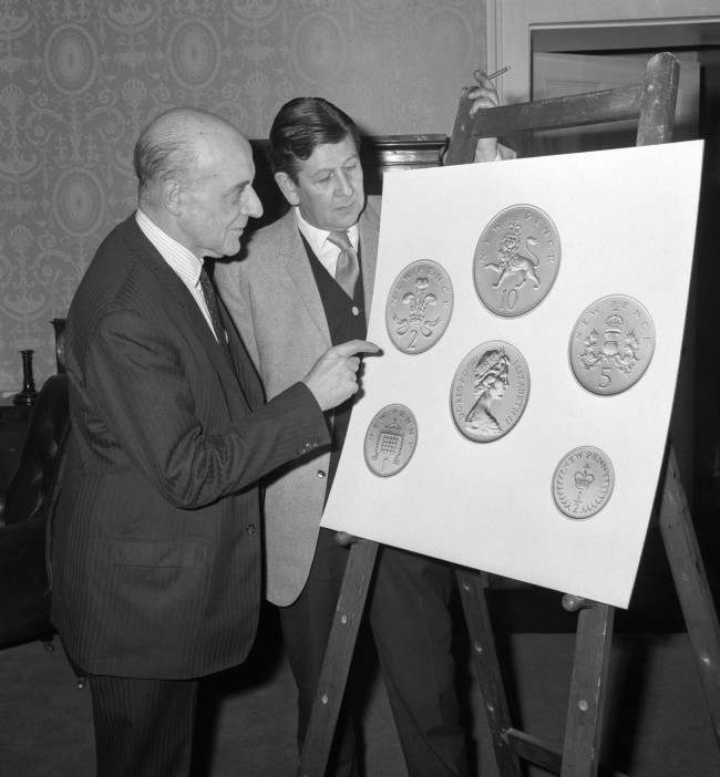 John Hastings James, Deputy Master and Comptroller of the Royal Mint, discussing the new decimal coinage with Christopher Ironside (right) who designed the reverses. Date: 15/02/1968