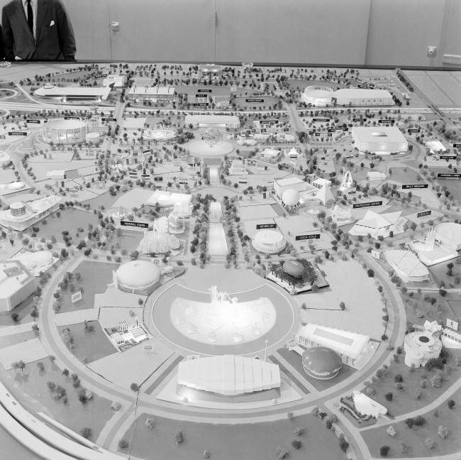 "Mushrooms and angular shapes of all sorts rise like geometric forms in this view of part of the model of the New York World's Fair which will open on April 22, 1964. In the center is the Promenade of Industry, from the Pool of Industry Dancing Waters fountains (lower center) to the stainless steel Unisphere. This representation of the globe will set the fair's theme shown May 1, 1963, ""Peace Through Understanding."" The buildings are those of U.S. industry and various states. (AP Photo/RG)"
