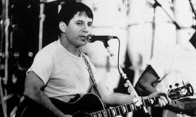 "American singer Paul Simon performs for 20,000 fans in an open air stadium in Harare, Zimbabwe on Feb. 14, 1987, the first day of a two-day ""Graceland in Concert"" event by Simon and 25 black South African musicians. It was Simon''s first public performance in Africa of his ""Graceland"" album which blends African rhythms with American pop music. (AP Photo)"