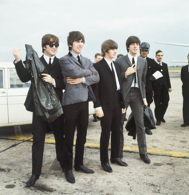 The Beatles Leave London Airport In 1964 From Left John Lennon George Harrison
