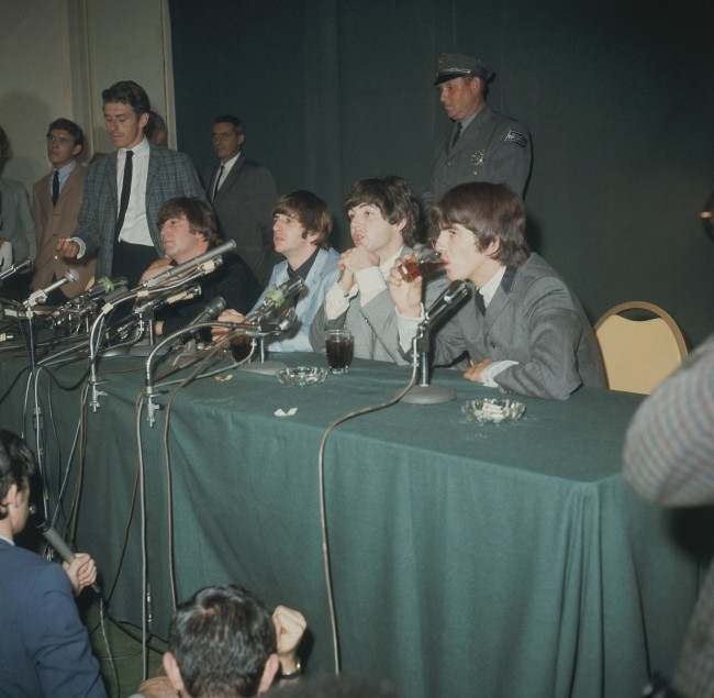 The Beatles are shown during a news conference in Forest Hills, N.Y., Feb. 1964. (AP Photo)