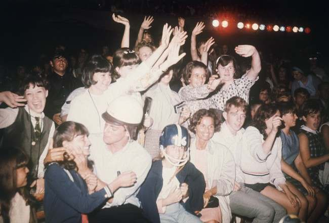 """American fans in New York react during the Beatles' concert on the """"Ed Sullivan Show"""", Feb. 8, 1964. (AP Photo)"""
