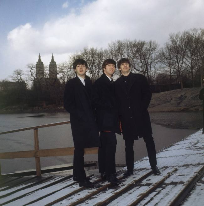 The Beatles walk around New York's Central Park, Feb. 10, 1964. From left: Paul McCartney, John Lennon and Ringo Starr. (AP Photo)
