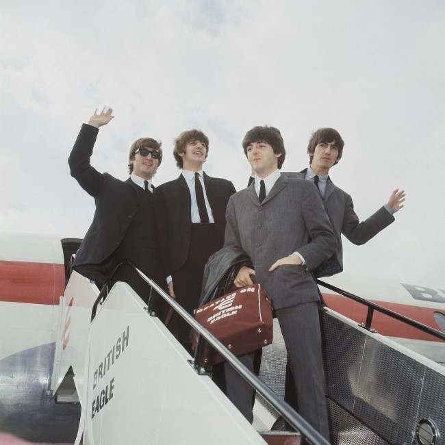 The Beatles leave London airport in 1964. From left: John Lennon, Ringo Starr, Paul McCartney and George Harrison. (AP Photo)