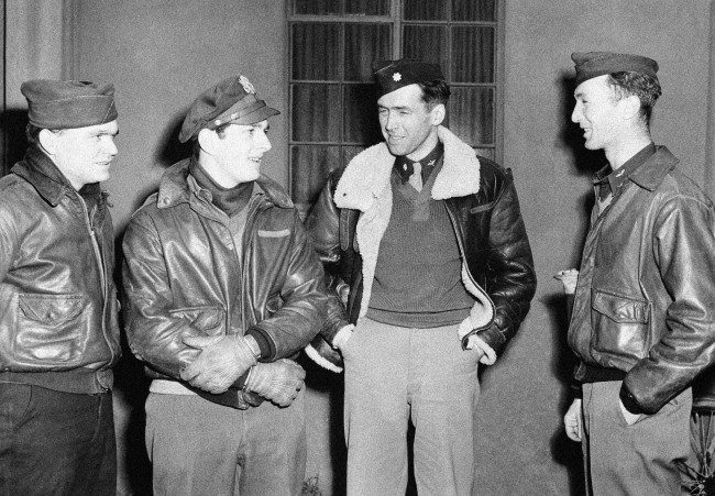 Film star Jimmy Stewart celebrates his promotion to major by leading his bomber group in a great raid on Frankfurt, Germany on Jan. 29, 1944. Left to right: Lt. John J. Rankin, bombardier, of Walhalla, S.C.; Lt. J.M. Steinhaven, navigator, of 125 Park Drive, River Forest, Ill.; Major James Stewart, command pilot and leader of the group; and Lt. F.W. Conley, pilot of Greenville, Maine. (AP Photo)