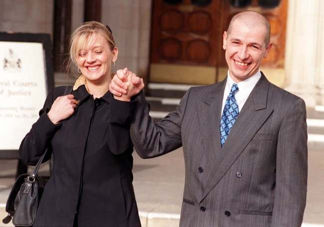Former Royal Marine Graham Pearson and his wife, Rose, smile and clasp hands in celebration after the High Court awarded Mr Pearson 57,000 in compensation for stress that he has suffered as a result of helping victims aboard the wreck of the British Midland jet that crashed on the M1 at Kegworth in 1989 with the loss of 47 lives, today (Monday). See PA Story COURTS Kegworth. Photo by Michael Stephens/PA. Date: 09/02/1998