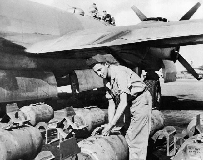 Sgt. John Greenstreet, the son of film actor, Sydney Greenstreet, handling bombs at the 20th Bomber Command in India on Feb. 6, 1945, where he is armament inspector. (AP Photo)