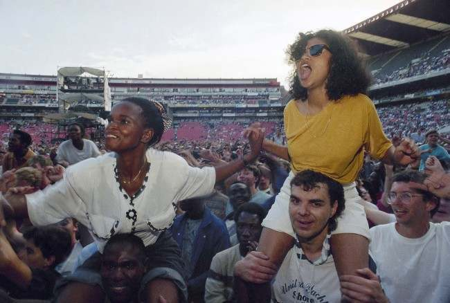Fans at American singer Paul Simon's concert in the first of five concerts in Johannesburg, South Africa on Saturday, Jan. 11, 1992. The concert effectively marked the end of South Africa''s cultural boycott. (AP Photo/Adil Bradlow)