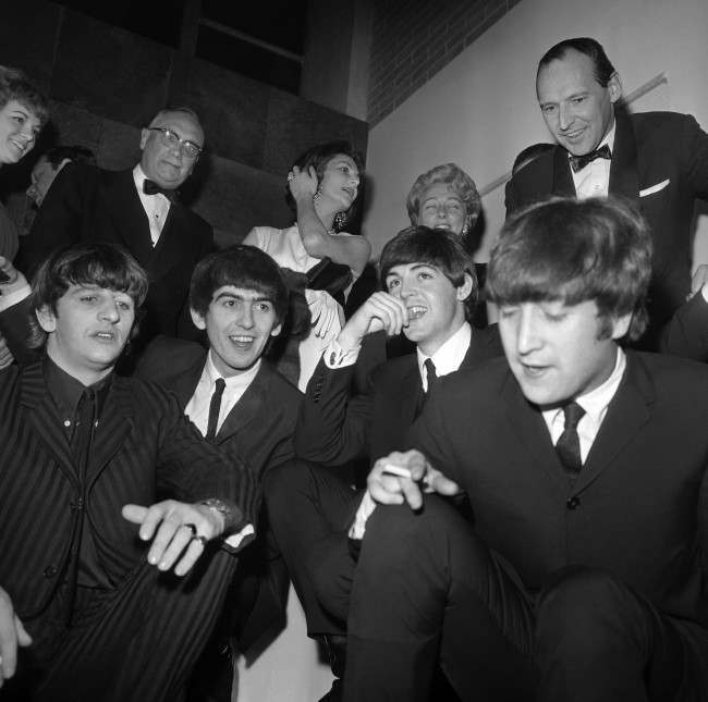 The centre of attraction, four boys from Liverpool enjoy themselves as they attend a charity ball at the British Embassy, in Washington, on Feb. 11, 1964. They are the Beatles , from left: Ringo Starr, George Harrison, Paul McCartney and John Lennon, currently raising a storm on their first tour of the United States. (AP Photo)