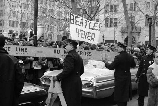 Police man the barricades outside New York''s Plaza Hotel, on Feb. 7, 1964, as Beatle maniacs push forward in hopes of a view of Britain''s singing sensations after their arrival for an American tour. (AP Photo)