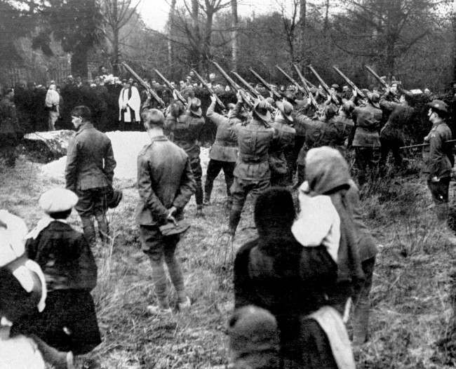 The military funeral of Baron Manfred Freiherr von Richthofen,the 'Red Baron', shot down on the 21st of April, 1918. At his burial at the village of Bertangles, near Amiens, riflemen from No.3 Squadron, Australian Flying Corps fired three volleys over the grave in tribute to the airman who had chalked up 80 kills.