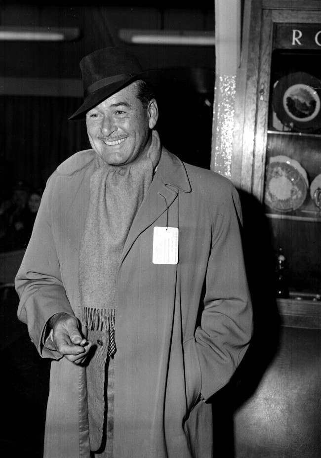Hollywood actor Errol Flynn at London Airport before leaving for America, 1957. PA/PA Archive/Press Association Images