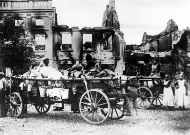 Civilians with their portable possessions loaded on wagons, in the ruins of a town destructed in the first sweep of the Czar's armies into German territory in an undated photo. (AP Photo)