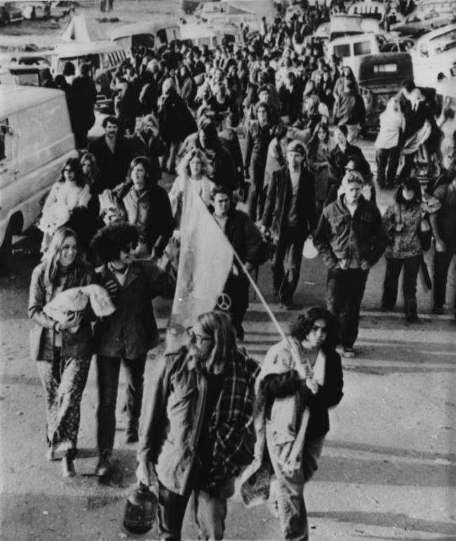 Rock fans abandon their cars as they march along the road to the site of a free rock concert at the Altamont Speedway, near Livermore, California, featuring The Rolling Stones, December 6, 1969.