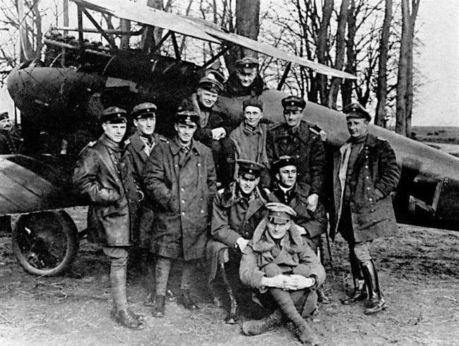 Baron Manfred Freiherr Von Richthofen sits in the cockpit of his Albatros fighter for a photograph with his squadron, Jagdstaffel III. Richthofen was credited with downing 80 Allied aircraft before being shot down over the Somme, Northern France, during what was known by pilots on both sides as 'Bloody' April, 1917. Manfred's brother, Lothar, is seated at front (fur collar).