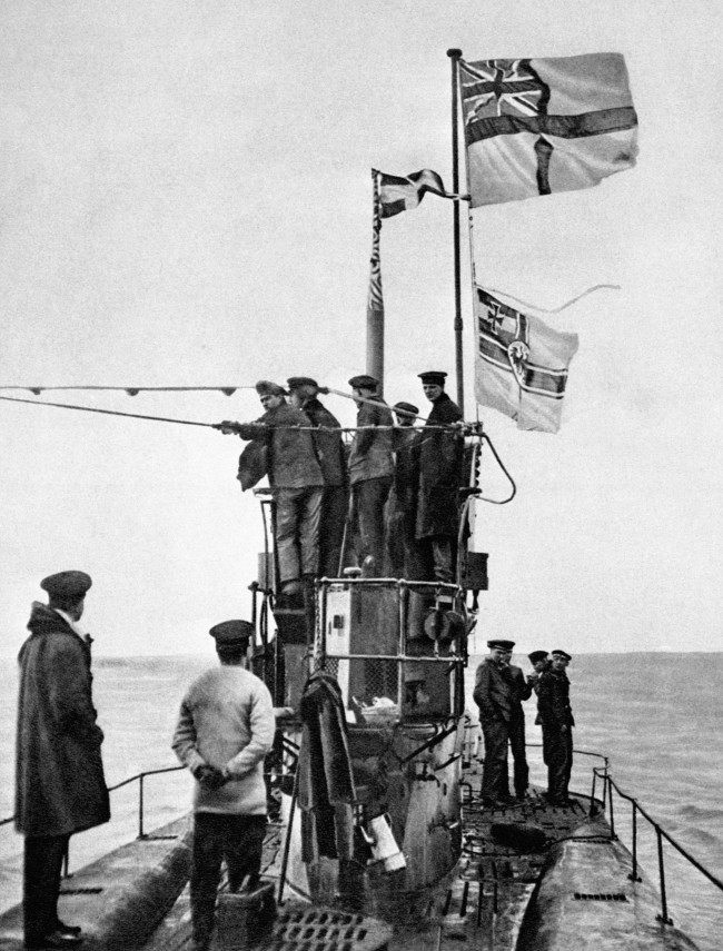 A view of the surrender of the German submarine U-48 to the Royal Navy at the Essex port of Harwich. The U-48 was one of 39 U-Boats to surrender, most of them in perfect condition. The White Ensign can be seen flying above the Imperial German Navy flag.