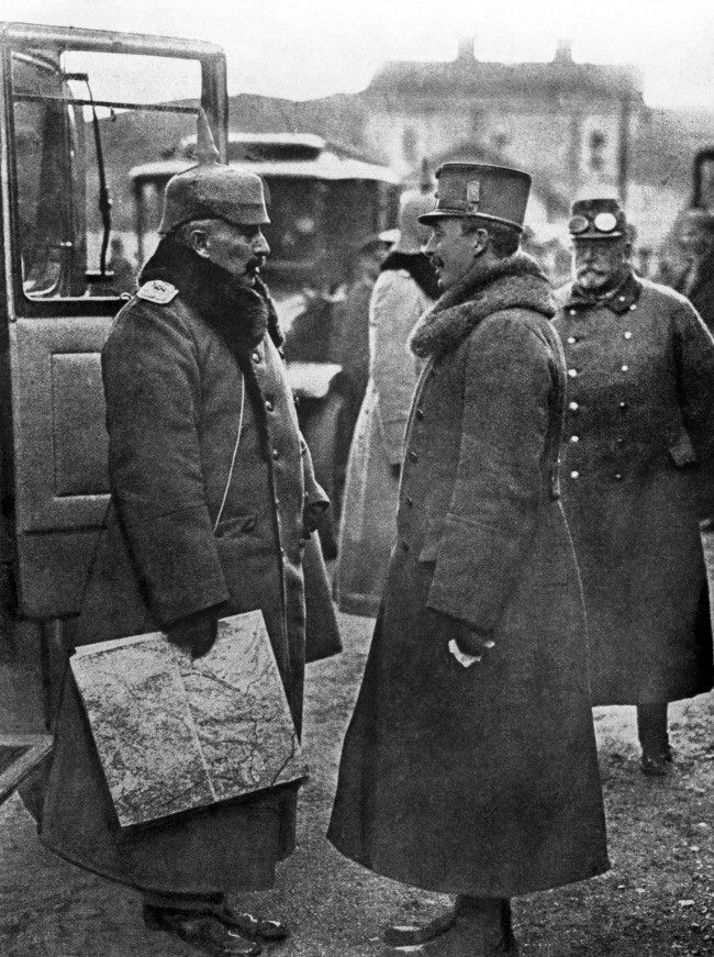 Kaiser Wilhelm II, the German Emperor, in conversation with Charles I, the Emperor of Austria, at a small railway station on the Italian Front.