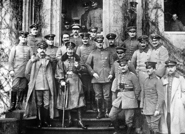 The Crown Prince Wilhelm at his temporary residence, surrounded by his staff officers. 1914